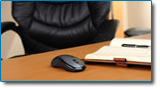The only way to know if bankruptcy is right for you is to discuss the details with an attorney. Image professional office desk with empty chair and appointment book.