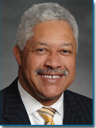 Julius J. Cherry, Esq., Bankruptcy Attorney - Image is portrait of distinguished black middle-aged man with grey hair and a well trimmed mustasch wearing a dark colored suit with white shirt and gold stripped tie.