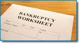 Not everyone will qualify for Chapter 7 bankruptcy relief. Image of bankruptcy worksheet on desktop.
