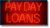 Payday loans can normally be discharged in bankruptcy. Image of red neon sign with workds payday loans on black background.